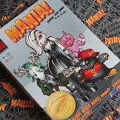 Mania!:n laatikko ja kortteja