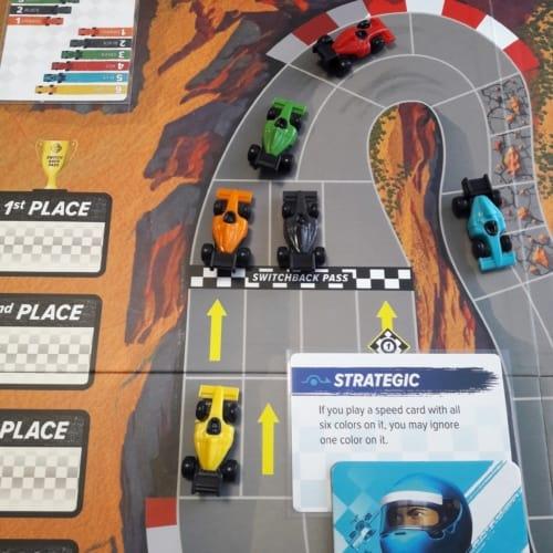 Sininen kuski, Strategic-kortti ja autot mutkassa